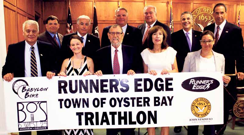 At the July 12 Oyster Bay Town Board Meeting, GLIRC and the Runner's Edge were on hand to thank town officials for their involvement and support. Pictured at the meeting are front row (from left): Town Supervisor John Venditto, Allison Cook of the Runner's Edge, GLIRC President Mike Polansky, GLIRC Executive Director Linda Ottaviano and Councilwoman Michelle Johnson. Rear (from left): Councilpersons Joe Pinto, Chris Coschignano and Anthony Macagnone, Receiver of Taxes Jim Stefanich, Councilman Joe Muscarella and Town Clerk Jim Altadonna.
