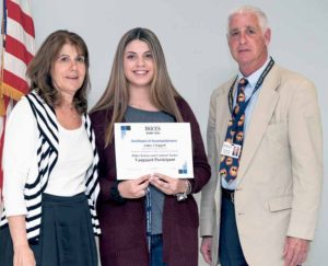 Hicksville student Ashley Chappell (center) earned the 2016 Vanguard Award from Nassau BOCES Barry Tech. She is congratulated by Barry Tech Principal Laurie Harris (left) and Nassau BOCES Board Member Michael Weinick.