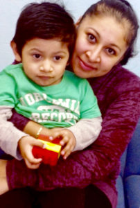 A mother works with her son to prepare him for preschool, under the guidance of specialists from the Nassau BOCES Parent-Child Home Program.