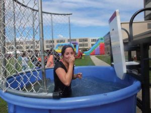 Hicksville High School alumna Jessica Ficke, a new fifth grade teacher at Burns Avenue School, takes her turn in the dunk tank.