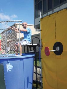 The Hicksville Congress of Teachers President Tom Glenn waits to get dunked—which happened mutiple times.