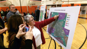 Residents look over proposed zoning maps at the Hicksville Downtown Revilatization meeting. (Photos by Chris Boyle)